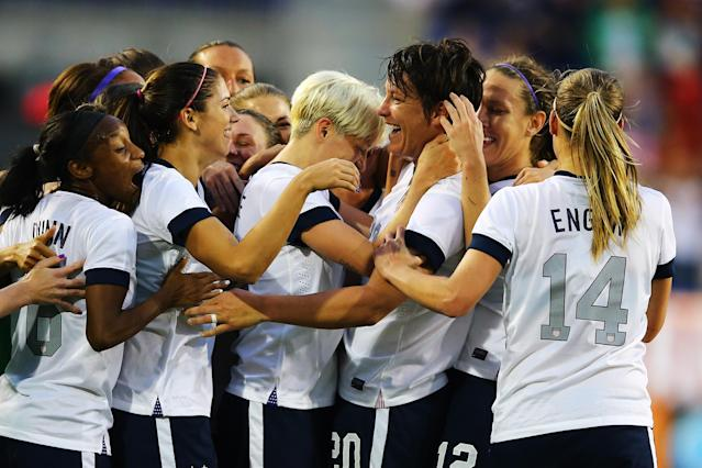 HARRISON, NJ - JUNE 20: Abby Wambach #20 of the USA celebrates with her teamates after passing Mia Hamm in alltime International total goals scored with her159th International goal against Korea Republic during the first half of their game at Red Bull Arena on June 20, 2013 in Harrison, New Jersey. (Photo by Al Bello/Getty Images)