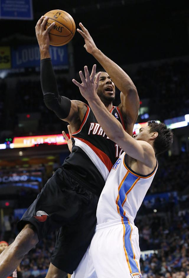 Portland Trail Blazers forward LaMarcus Aldridge, left, shoots over Oklahoma City Thunder center Steven Adams, right, in the first quarter of an NBA basketball game in Oklahoma City, Tuesday, Jan. 21, 2014. (AP Photo/Sue Ogrocki)