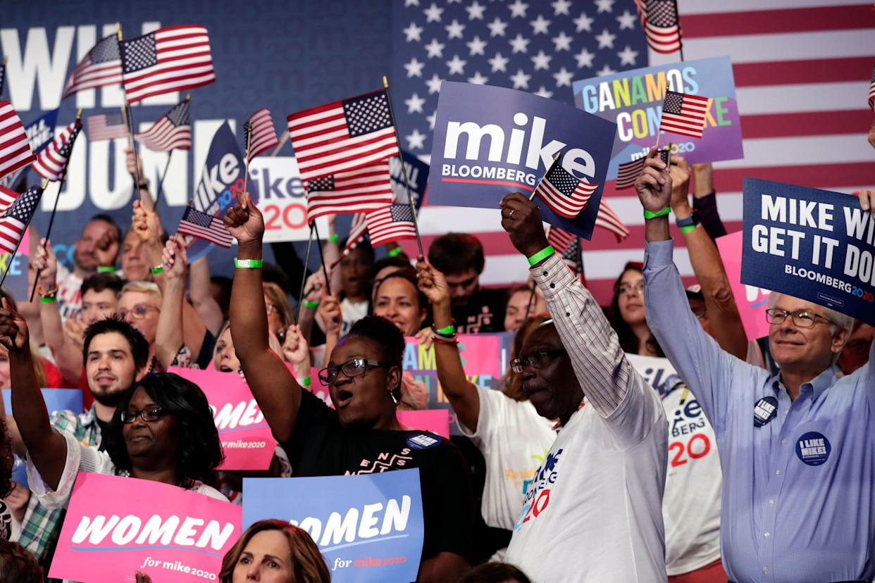 Supporters of Democratic presidential candidate Mike Bloomberg attend a primary election night campaign rally Tuesday in West Palm Beach, Florida.
