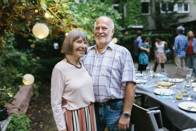 Portrait Of Elderly Couple At Family BBQ