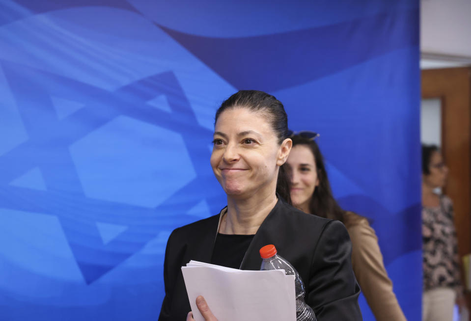 """Israeli Minister of Transportation Merav Michaeli arrives for the first weekly cabinet meeting of the new government in Jerusalem, Sunday, June 20, 2021. Prime Minister Naftali Bennett opened his first Cabinet meeting on Sunday since swearing in his new coalition government with a condemnation of the newly elected Iranian president, whom he called """"the hangman of Tehran."""" (Emmanuel Dunand/Pool Photo via AP)"""