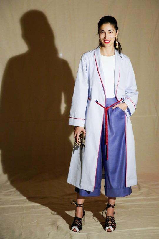 <p>Only the 'Tank' magazine founder can make a robe look sophisticated outside the pages of a fashion magazine. She looks more comfortable than anyone else, in culottes, a basic white tee, and chunky heels (not to mention the Thakoon robe). To top it all off? A punchy red lip.  </p>