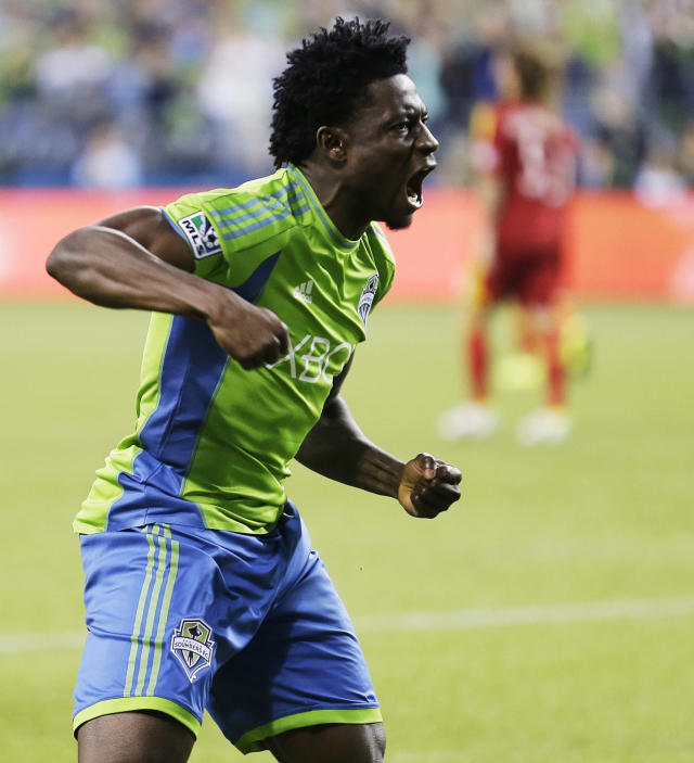 Seattle Sounders' Obafemi Martins celebrates his goal against Real Salt Lake in the first half of an MLS soccer match, Friday, Sept. 13, 2013, in Seattle. (AP Photo/Ted S. Warren)