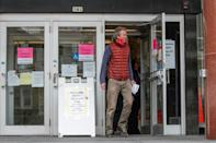 A man leaves the Frank P. Zeidler Municipal Building after not being able to cast his ballot at the already closed drop-off site in Milwaukee, Wisconsin, on April 6, 2020