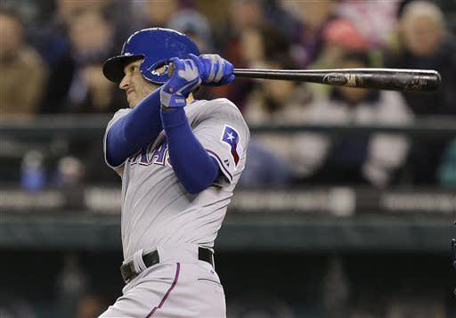 Texas Rangers Ian Kinsler singles against the Seattle Mariners in the sixth inning of a baseball game, Friday, April 12, 2013, in Seattle. (AP Photo/Ted S. Warren)