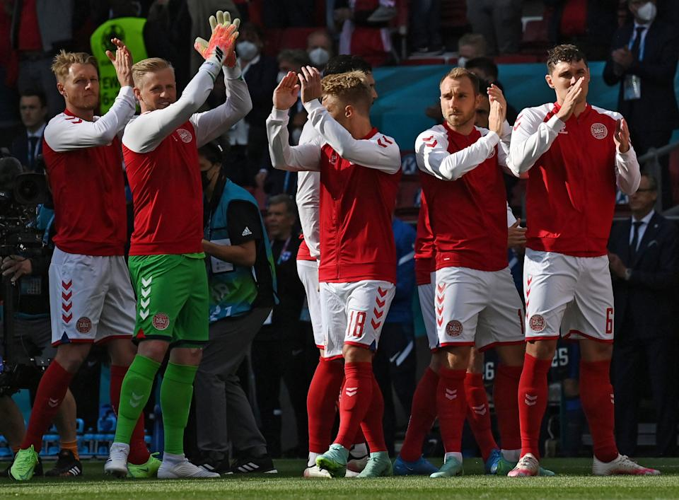 Denmark's midfielder Christian Eriksen (2R) applauds with teammates before the UEFA EURO 2020 Group B football match between Denmark and Finland at the Parken Stadium in Copenhagen on June 12, 2021. (Photo by Jonathan NACKSTRAND / POOL / AFP) (Photo by JONATHAN NACKSTRAND/POOL/AFP via Getty Images)