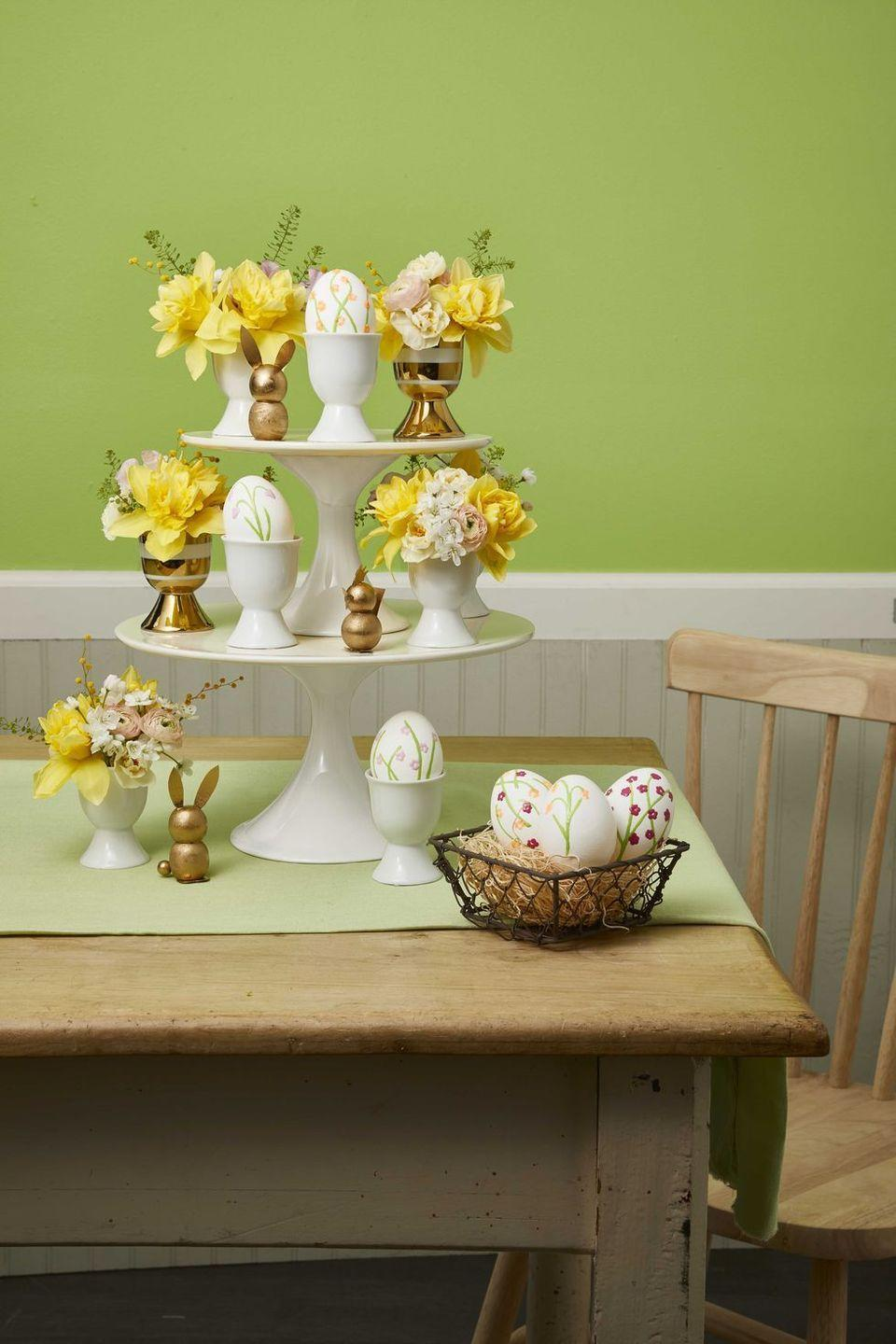 """<p>After the kids decorate their Easter eggs, show them off with this elegant DIY cake stand.</p><p><strong><em><a href=""""https://www.womansday.com/home/decorating/g1100/easter-brunch/?slide=1"""" rel=""""nofollow noopener"""" target=""""_blank"""" data-ylk=""""slk:Get the Cake Stand Centerpiece tutorial."""" class=""""link rapid-noclick-resp"""">Get the Cake Stand Centerpiece tutorial.</a></em></strong></p><p><strong><a class=""""link rapid-noclick-resp"""" href=""""https://www.amazon.com/VILAVITA-Cupcake-Dessert-Birthday-Celebration/dp/B074TF6YB4?tag=syn-yahoo-20&ascsubtag=%5Bartid%7C10070.g.1751%5Bsrc%7Cyahoo-us"""" rel=""""nofollow noopener"""" target=""""_blank"""" data-ylk=""""slk:SHOP CAKE STANDS"""">SHOP CAKE STANDS</a></strong></p>"""