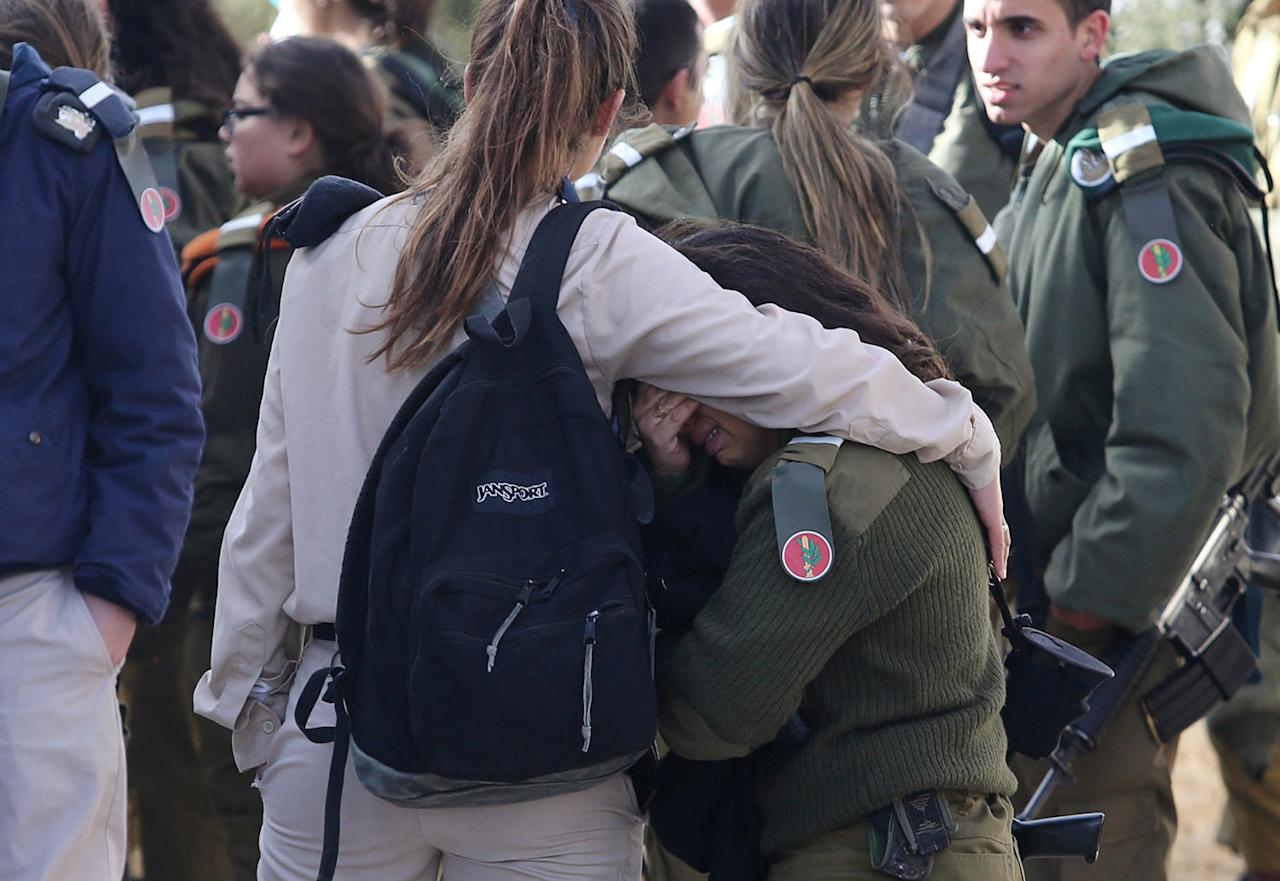 <p>An Israeli soldier hugs her friend near the scene where police said a Palestinian rammed his truck into a group of Israeli soldiers on a popular promenade in Jerusalem, killing four people and injuring about 15 others in a deliberate attack, Jan. 8, 2017. (Photo: Gil Yohanan/Reuters) </p>