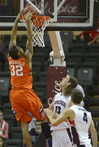 Clemson forward K.J. McDaniels (32) dunks the ball over Gonzaga's Kelly Olynyk (13) and Kevin Pangos (4) during the first half of an NCAA college basketball game at the Old Spice Classic in Kissimmee, Fla., Thursday, Nov. 22, 2012. (AP Photo/Phelan M. Ebenhack)