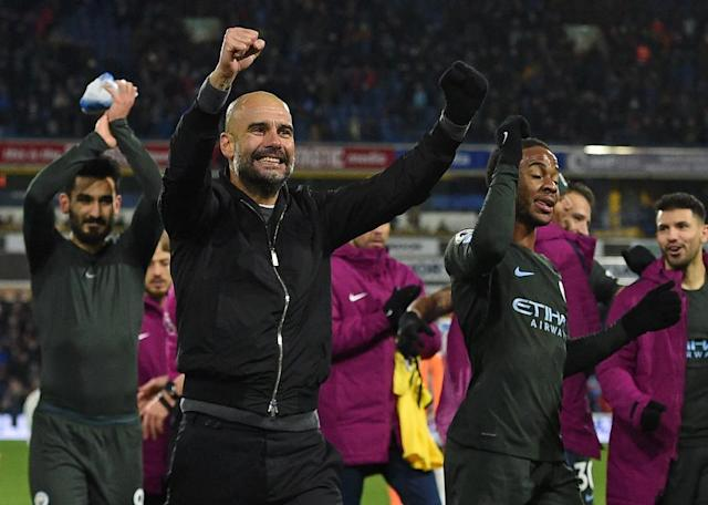 Guardiola has now won league titles as a coach in Spain, Germany and England. (AFP Photo/Oli SCARFF )