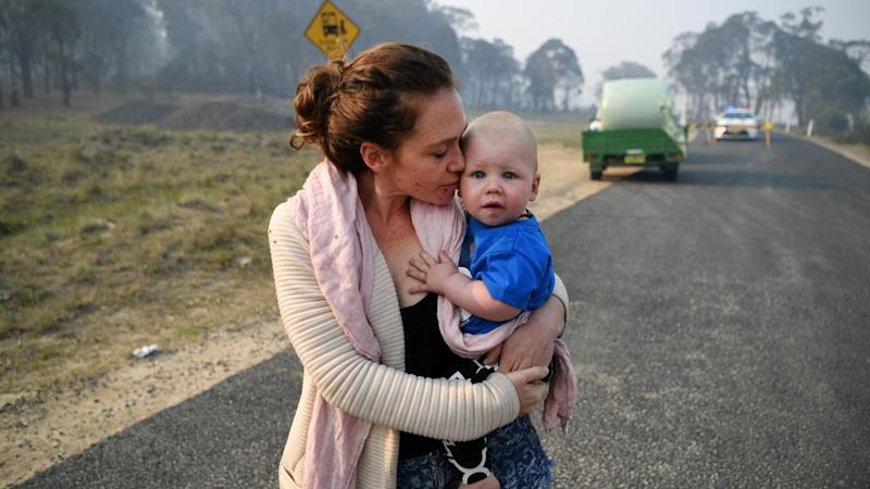 Wytaliba resident Storm Sparks and son Zeke Bacon had to wait as bushfires raged near their home