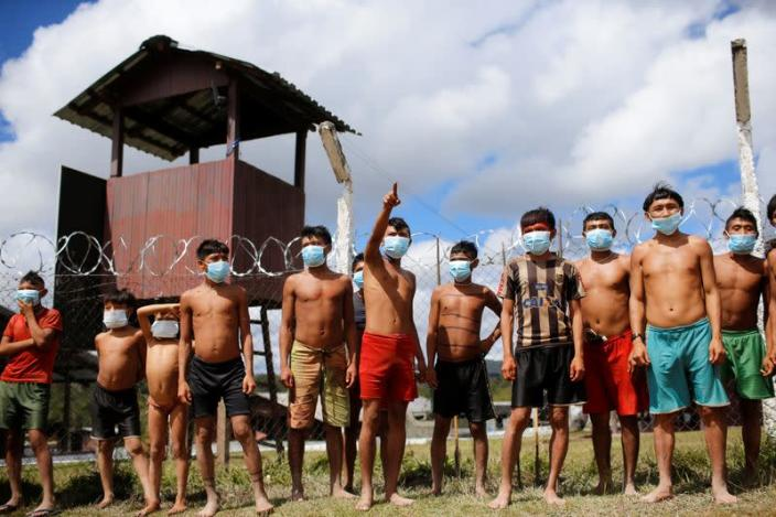 FILE PHOTO: Indigenous people from Yanomami ethnic group are seen at the 4th Surucucu Special Frontier Platoon of the Brazilian army in the municipality of Alto Alegre