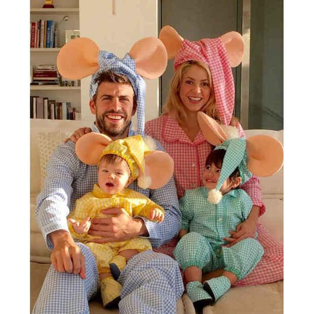 Gerard Pique with family and children. They are all dressed in pyjamas of different colours, with mouse ears.