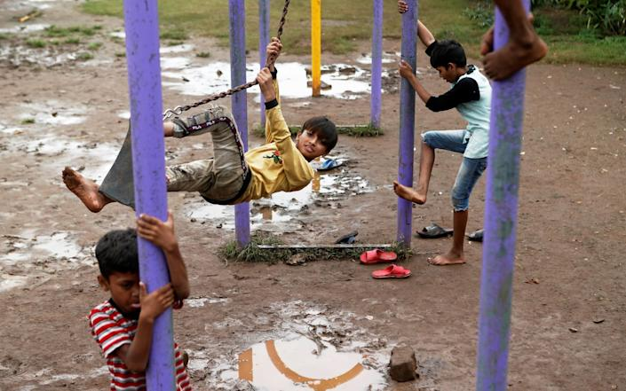 Children play at a park amidst the spread of the coronavirus disease in Mumbai - Reuters