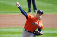 Houston Astros pitcher Zack Greinke throws against the Minnesota Twins in the first inning of an American League wild-card series baseball game Tuesday, Sept 29, 2020, in Minneapolis. (AP Photo/Jim Mone)