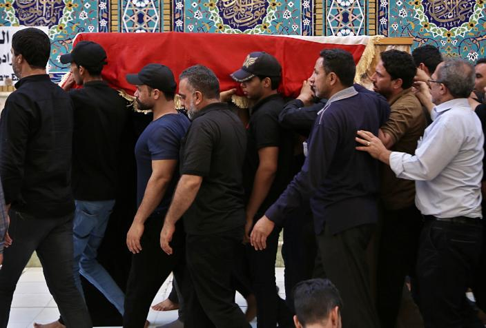 Mourners carry the flag-draped coffin of a protester killed during anti-government protesters during his funeral at the Imam Ali shrine in Najaf, Iraq, Saturday, Oct. 5, 2019. The spontaneous protests which started Tuesday in Baghdad and southern cities were sparked by endemic corruption and lack of jobs. Security responded with a harsh crackdown, leaving more than 70 killed. (AP Photo/Anmar Khalil)