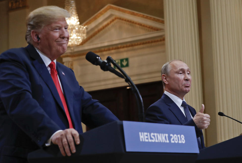FILE - In this July 16, 2018, file photo Russian President Vladimir Putin, right, and U.S. President Donald Trump give a joint news conference at the Presidential Palace in Helsinki, Finland. For the past three years, the administration has careered between President Donald Trump's attempts to curry favor and friendship with Vladimir Putin and longstanding deep-seated concerns about Putin's intentions. (AP Photo/Pablo Martinez Monsivais, File)