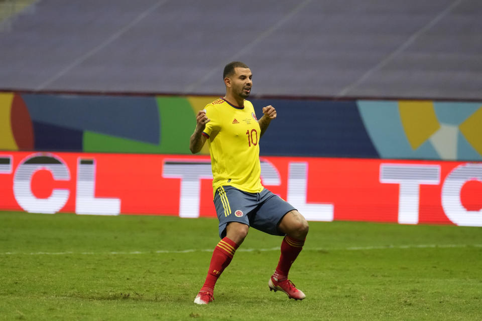 Colombia's Edwin Cardona reacts after Argentina's goalkeeper Emiliano Martinez block his shot in a penalty shootout during a Copa America semifinal soccer match at the National stadium in Brasilia, Brazil, Wednesday, July 7, 2021. (AP Photo/Andre Penner)