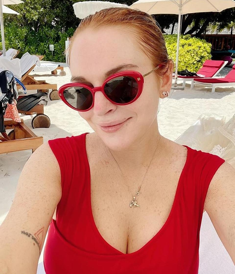 """<p><strong>Location:</strong> Maldives</p> <p>Lindsay Lohan sported all red while <a href=""""https://www.instagram.com/p/CNxUHBaBtAl/"""" rel=""""nofollow noopener"""" target=""""_blank"""" data-ylk=""""slk:sitting beachside"""" class=""""link rapid-noclick-resp"""">sitting beachside</a> at the <a href=""""https://www.marriott.com/hotels/travel/mlewh-w-maldives/"""" rel=""""nofollow noopener"""" target=""""_blank"""" data-ylk=""""slk:W Maldives"""" class=""""link rapid-noclick-resp"""">W Maldives</a> resort. The five-star private island features infinity pools, reefs, turquoise waters and overwater bungalows. </p>"""