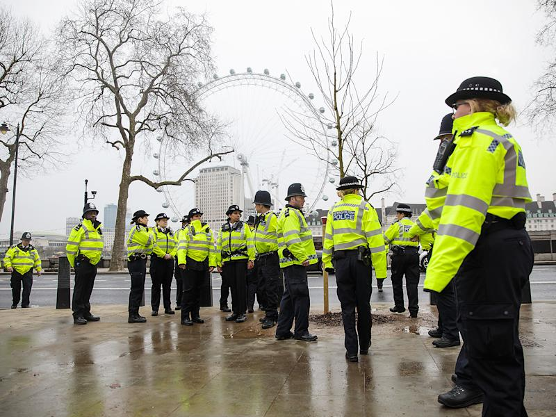 Police officers assemble on Victoria Embankment following yesterday's attack in London, England: Getty Images