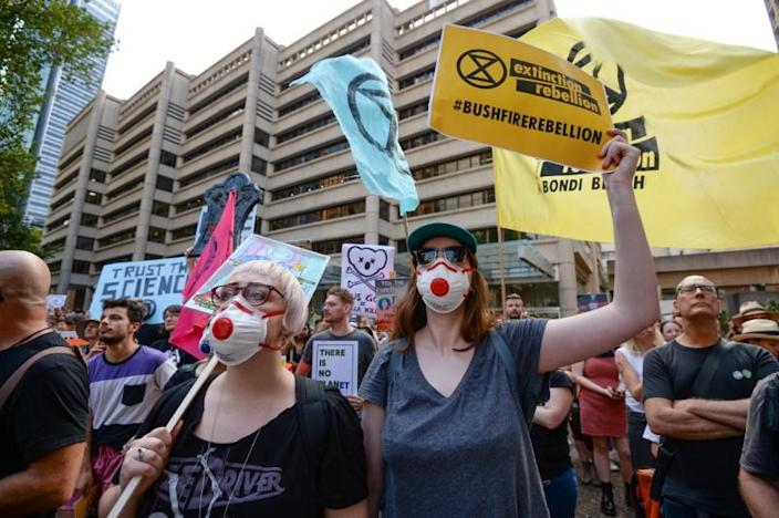 Protesters hold placards during a climate change rally in Sydney
