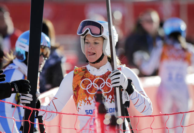 United States' Julia Mancuso sticks out her tongue in the finish area after a women's downhill training run for the Sochi 2014 Winter Olympics, Saturday, Feb. 8, 2014, in Krasnaya Polyana, Russia. (AP Photo/Gero Breloer)