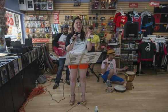 The band FunikiJam plays at the wedding ceremony of Jason Welker and Scott Everhart (unseen) at a comic book retail shop in Manhattan, New York June 20, 2012.