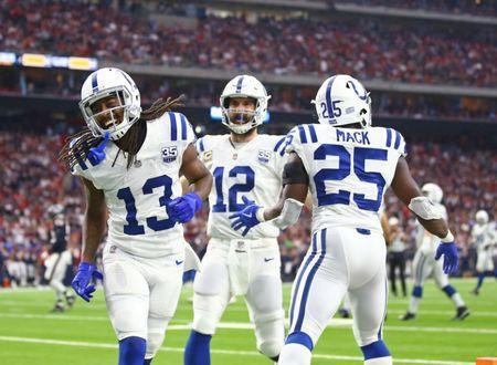 Jan 5, 2019; Houston, TX, USA; Indianapolis Colts wide receiver T.Y. Hilton (13), quarterback Andrew Luck (12) and running back Marlon Mack (25) celebrate a second quarter touchdown against the Houston Texans during the AFC Wild Card at NRG Stadium. Mandatory Credit: Mark J. Rebilas-USA TODAY Sports