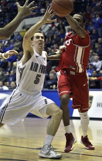 Air Force's Mike Fitzgerald, left, blocks a pass by an unidentified New Mexico player during the first half of an NCAA college basketball game in Air Force Academy, Colo., Saturday, March 9, 2013. (AP Photo/Brennan Linsley)