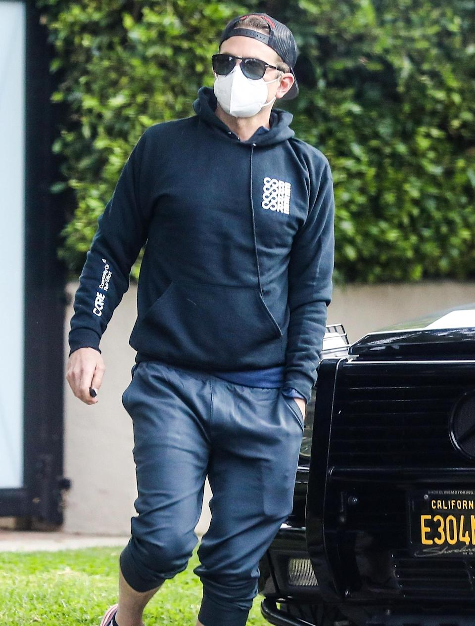 <p>Bradley Cooper wears a sweatshirt and joggers after a workout session at a private gym in Santa Monica on Wednesday.</p>