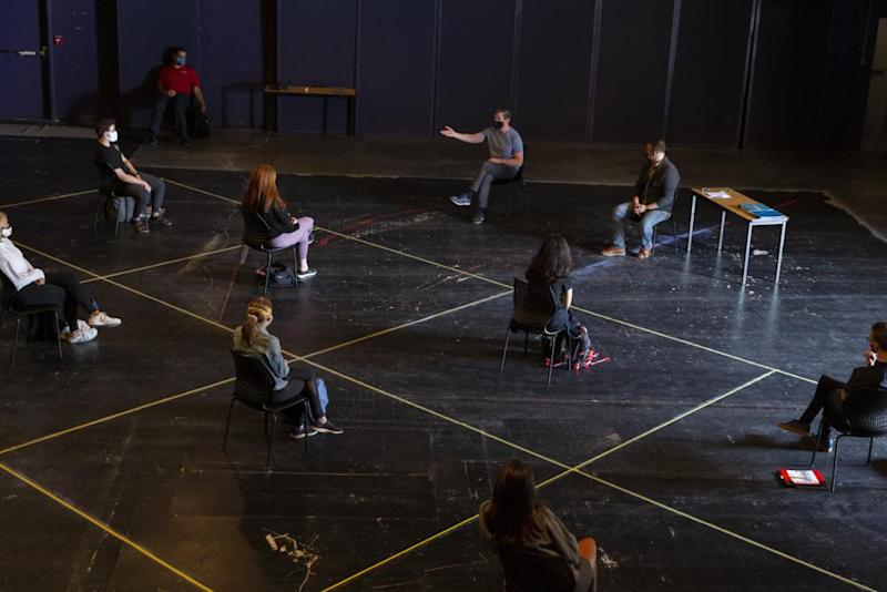 Students listen to an instructor while maintaining social distancing during an acting class at the University of Arizona in Tucson on 24 August.