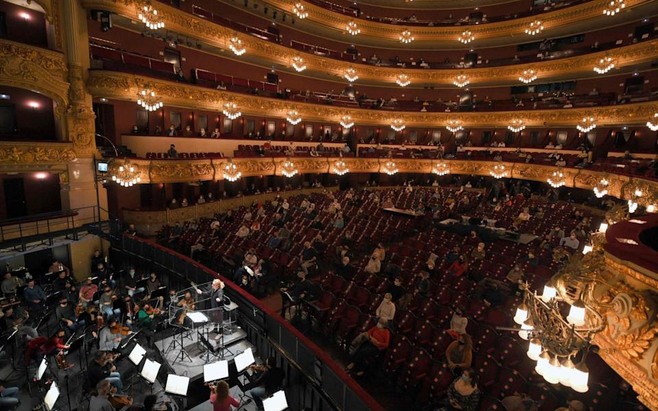 People attend a rehearsal of Giuseppe Verdi's La Traviata with a 21.8 percent attendance capacity as part of coronavirus restrictions at the Liceu Grand Theatre in Barcelona on November 24, 2020 - Lluis Gene/AFP