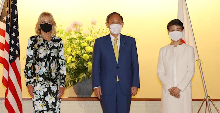 Japanese Prime Minister Yoshihide Suga (C) and his wife Mariko Suga meet with first lady Jill Biden (L) at the Akasaka State Guest House in Tokyo on July 22, 2021 on the eve of Tokyo 2020 Olympic Games. / Credit: STR/JAPAN POOL/AFP via Getty Images