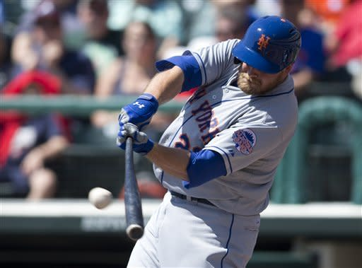 New York Mets' Lucas Duda hits a solo home run during the second inning of an exhibition spring training baseball game against the Atlanta Braves on Friday, March 15, 2013, in Kissimmee, Fla. (AP Photo/Evan Vucci)