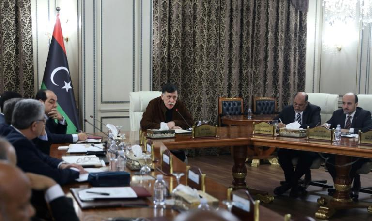 Libya's UN-recognised Prime Minister Fayez al-Sarraj (C) presided over a cabinet meeting where the implementation of a military deal with Turkey was 'unanimously approved' (AFP Photo/-)