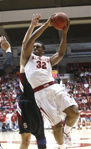 Alabama guard Retin Obasohan (32) drives to the basket against Stanford during the first half of an NCAA basketball game in the second round of the NIT on Saturday March 23, 2013 at Coleman Coliseum in Tuscaloosa, Ala. (AP Photo/The Tuscaloosa News, Robert Sutton)