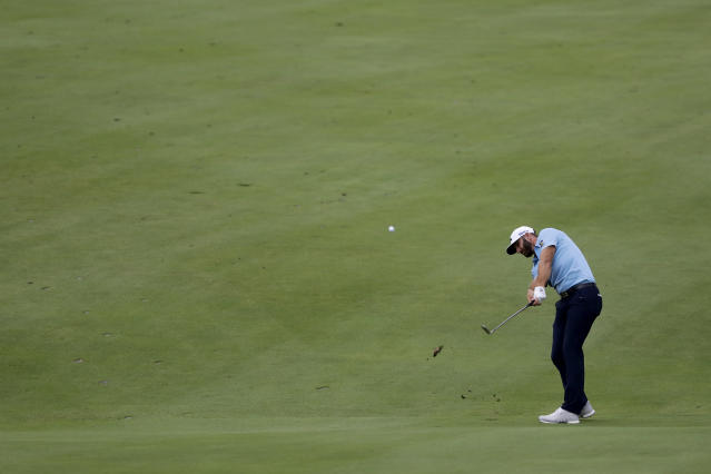 Dustin Johnson hits a shot from the 18th fairway during the final round of the Travelers Championship golf tournament at TPC River Highlands, Sunday, June 28, 2020, in Cromwell, Conn. (AP Photo/Frank Franklin II)