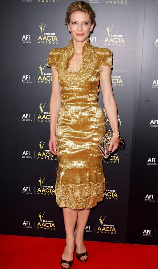 Celebrity fashion gold dresses: Cate Blanchett went all out with a bright and bold shade of gold. She oozed confidence in a metallic dress at the AACTA Awards.