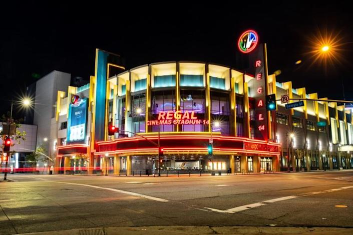 """LOS ANGELES, CA --MARCH 21, 2020 -The Regal LA Live & 4DX theatre is lit up and empty at 8 p.m., in downtown Los Angeles, CA, on Saturday night, March 21, 2020. This was the first weekend night under California Gov. Gavin Newsom's """"Safer at Home"""" mandate, which implored all Californians to stay home in an effort to slow the spread of the coronavirus. (Jay L. Clendenin / Los Angeles Times)"""
