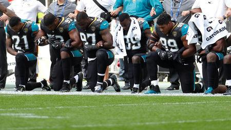 NFL Football - Jacksonville Jaguars vs Baltimore Ravens - NFL International Series - Wembley Stadium, London, Britain - September 24, 2017   Jacksonville Jaguars players kneel during the U.S. national anthem before the match   Action Images via Reuters/Paul Childs