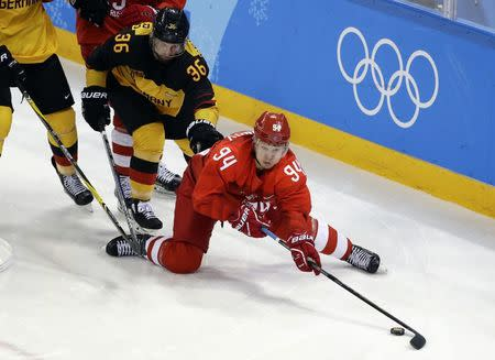 Ice Hockey - Pyeongchang 2018 Winter Olympics - Men Final Match - Olympic Athletes from Russia v Germany - Gangneung Hockey Centre, Gangneung, South Korea - February 25, 2018 - Yannic Seidenberg of Germany and Olympic Athlete from Russia Alexander Barabanov in action. REUTERS/David W Cerny