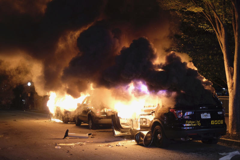 Cars were set on fire during protests in Atlanta as tensions continue to rise over the death of George Floyd.