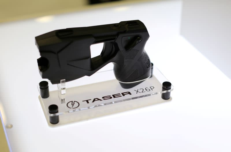 FILE PHOTO: An X26P Taser gun is shown on display at the Taser booth during the International Association of Chiefs of Police conference in San Diego