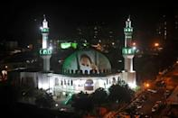 Images of health workers are projected onto the roof of the Omar Ibn Al-Khattab mosque in Foz do Iguacu, Brazil