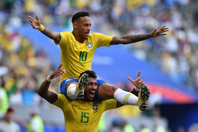 Brazil's forward Neymar celebrates with Brazil's midfielder Paulinho after scoring the opening goal during the Russia 2018 World Cup round of 16 football match between Brazil and Mexico at the Samara Arena in Samara on July 2, 2018. (Getty Images)