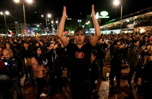 A conductor leads musicians performing in Bogota on the seventh consecutive day of protests against the government of Colombian President Ivan Duque