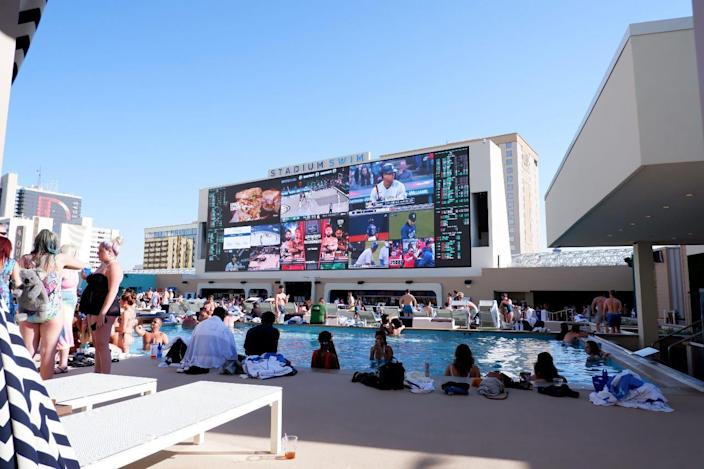 Catch the scores at poolside.