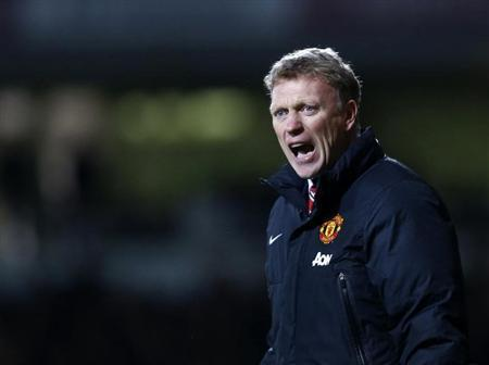 Manchester United manager Moyes reacts during their English Premier League soccer match against West Ham United at the Boleyn Ground in London