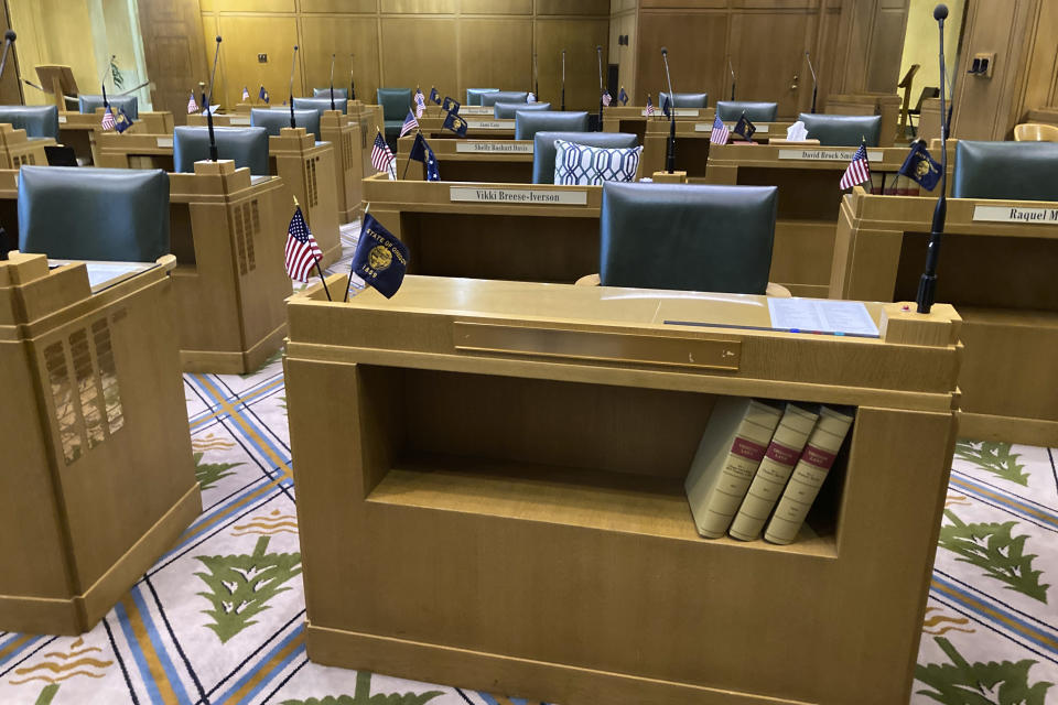 The desk of former Oregon state Rep. Mike Nearman, who was ousted by the House in a historic vote Thursday night, is seen with the nameplate removed Friday, June 11, 2021, at the Oregon State Capitol in Salem, Oregon. Republican lawmakers voted with majority Democrats to take the historic step of expelling the Republican member who let violent, far-right protesters into the state Capitol on Dec. 21. (AP Photo/Andrew Selsky)