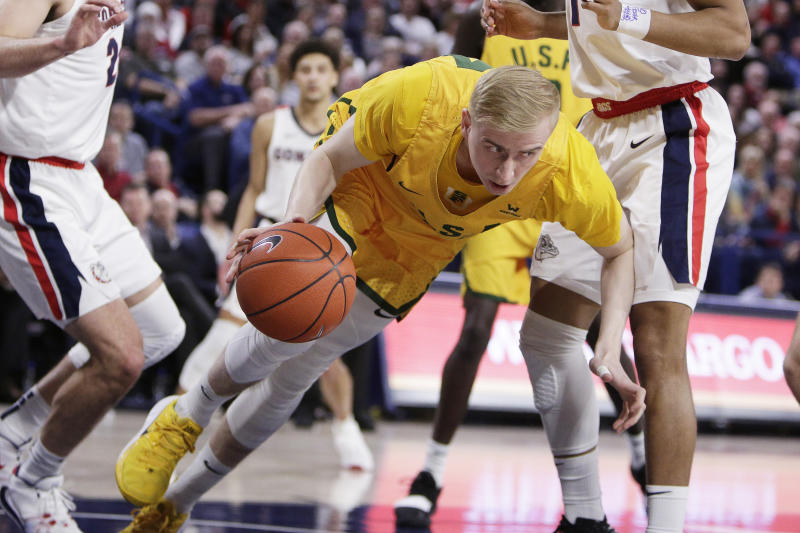 San Francisco forward Taavi Jurkatamm gains control of a rebound as he falls during the first half of the team's NCAA college basketball game against Gonzaga in Spokane, Wash., Thursday, Feb. 20, 2020. (AP Photo/Young Kwak)